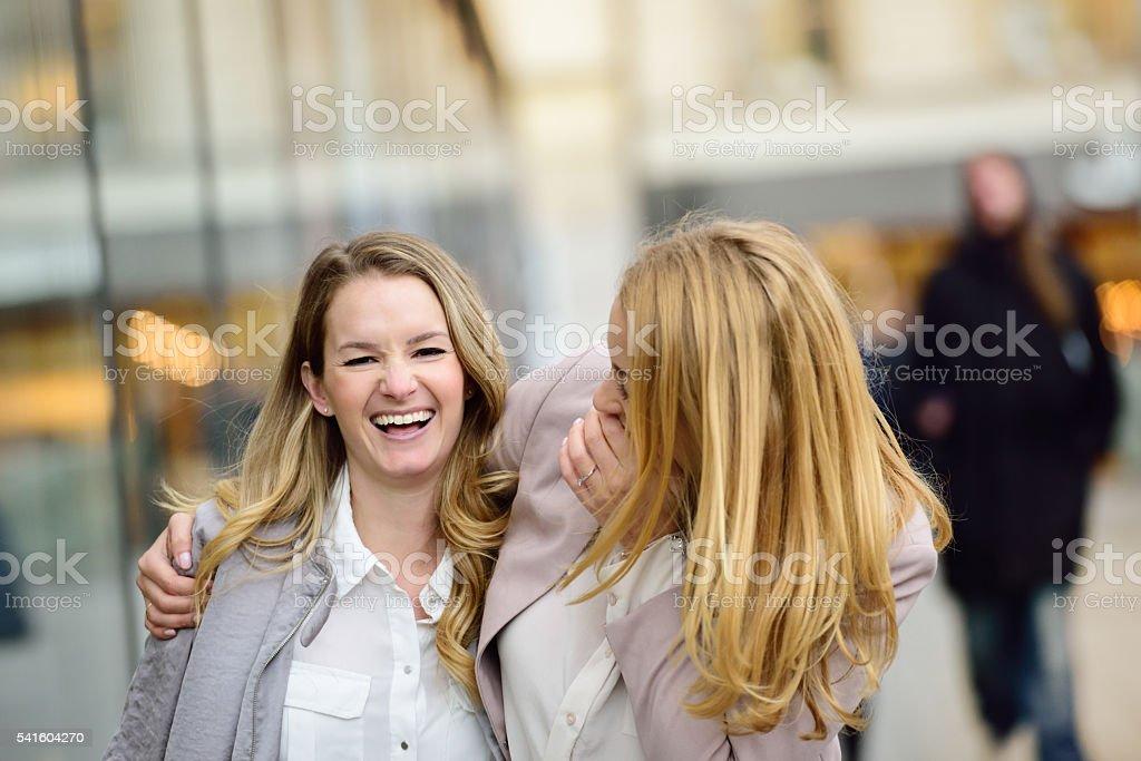 Swedish blonde business women having fun at Sergels Torg stock photo