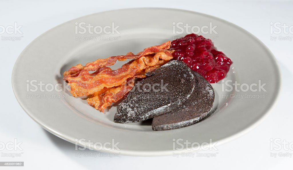 Swedish Blood Pudding with Bacon and Lingonberry Jam stock photo
