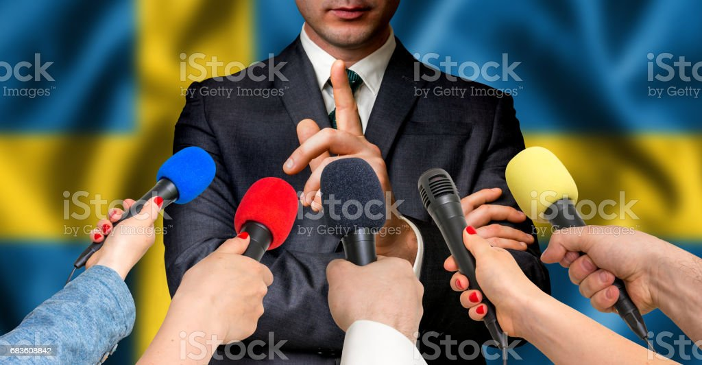 Swedish candidate speaks to reporters - journalism concept stock photo