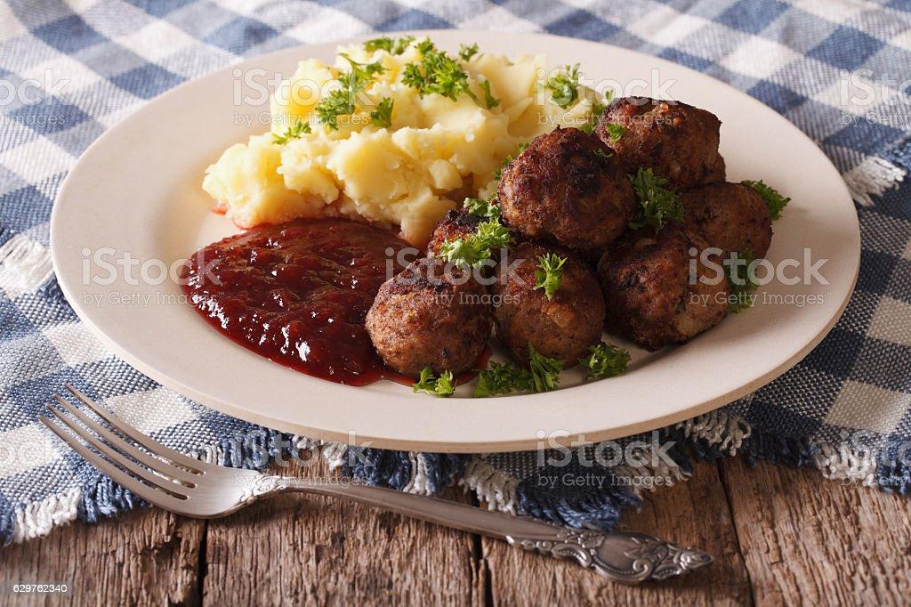 Swedish cuisine: meatballs, lingonberry sauce, potato closeup stock photo