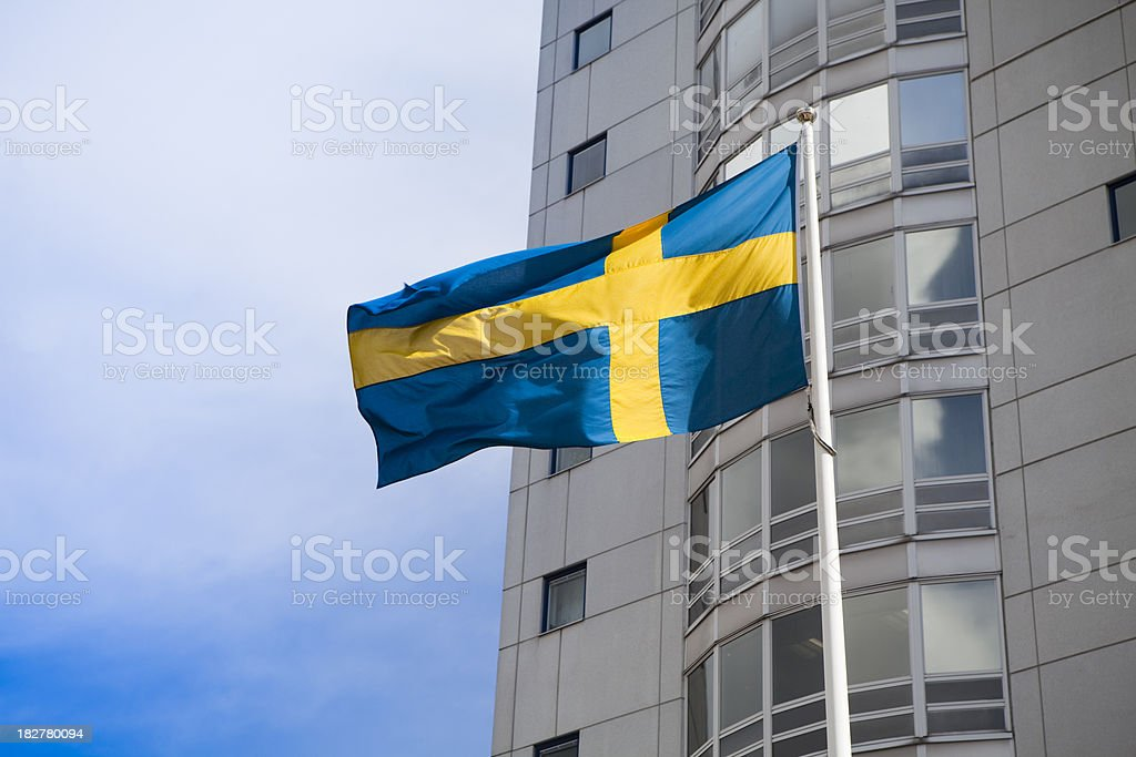 Swedish flag in front of corporate office buildings royalty-free stock photo