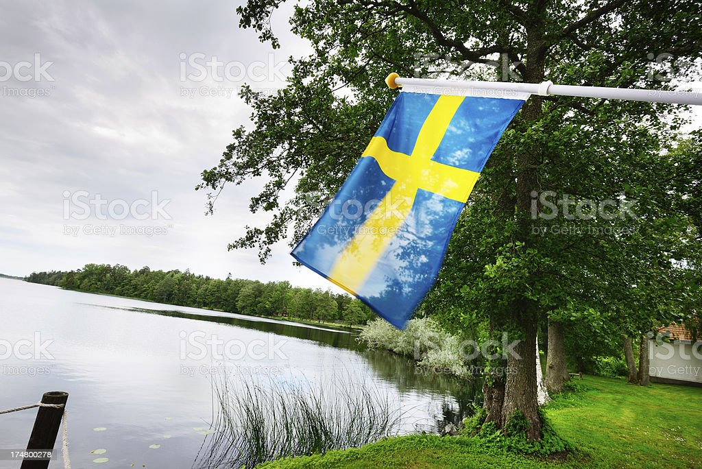 Swedish flag in typical environment stock photo