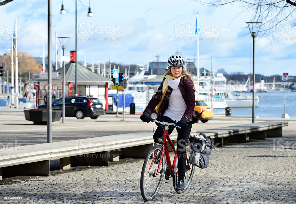 Swedish girl and bicycle, traffic in background stock photo