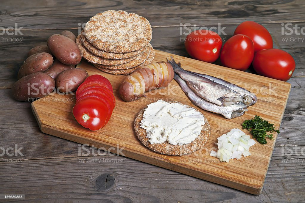 Swedish herring and ingredients on the cutting board royalty-free stock photo