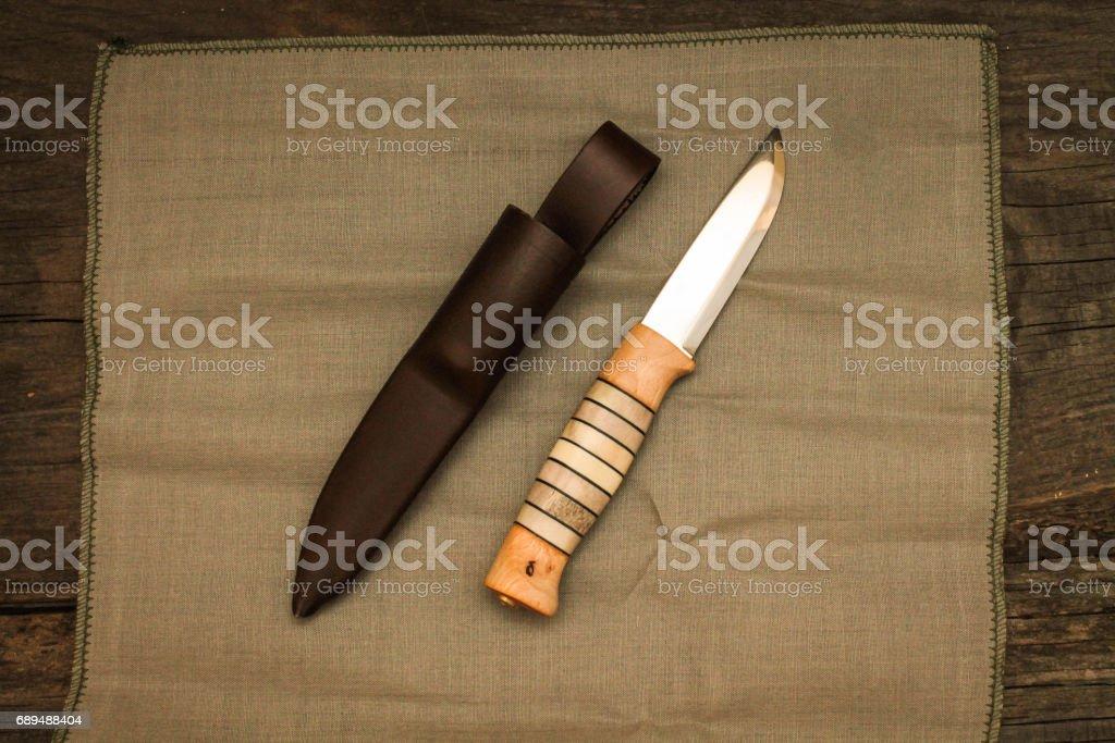 Swedish knife with leather sheath. Knife Swedish hunting. Knife with typing handle. stock photo