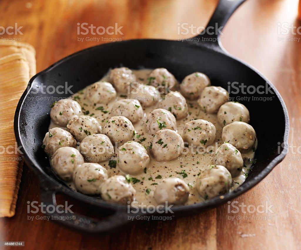 swedish meatballs in iron skillet stock photo
