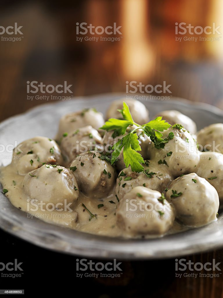 swedish meatballs with parlsey on plate stock photo