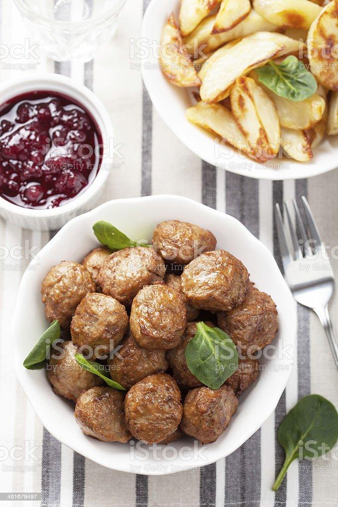 swedish meatballs with potatoes and lingon jam stock photo