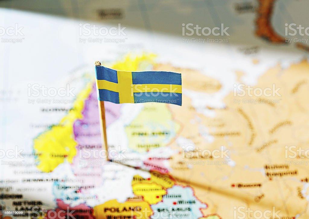 Swedish national flag marks Sweden on European map royalty-free stock photo