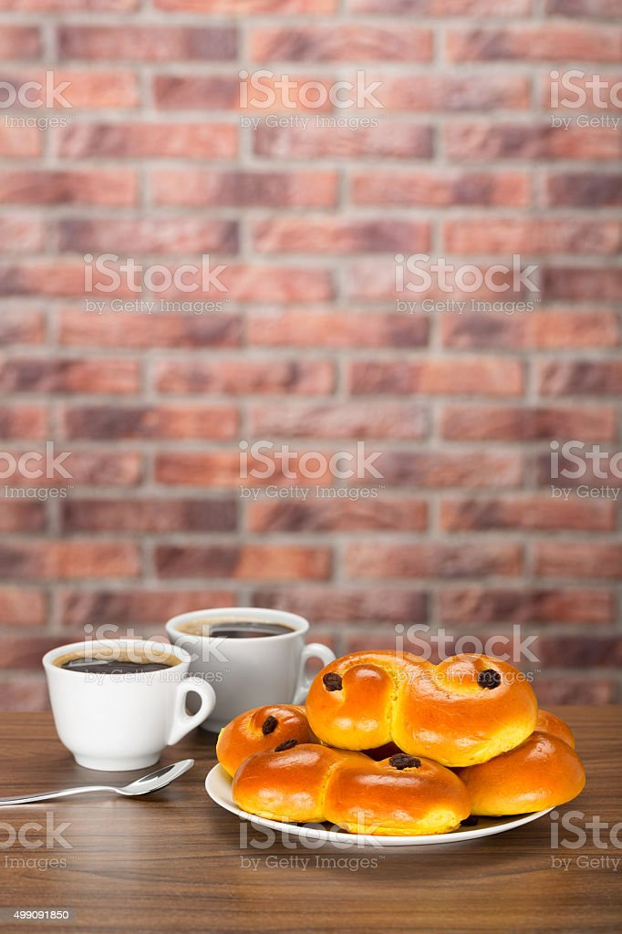 Swedish saffron buns with coffee. stock photo