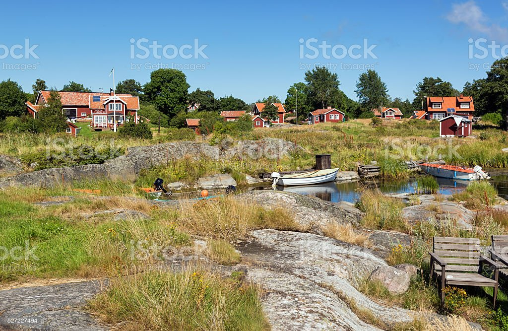 Swedish village with red cottages. stock photo