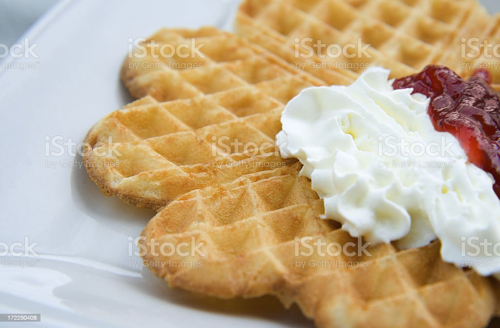 Swedish waffle with strawberry jam and whipped cream royalty-free stock photo
