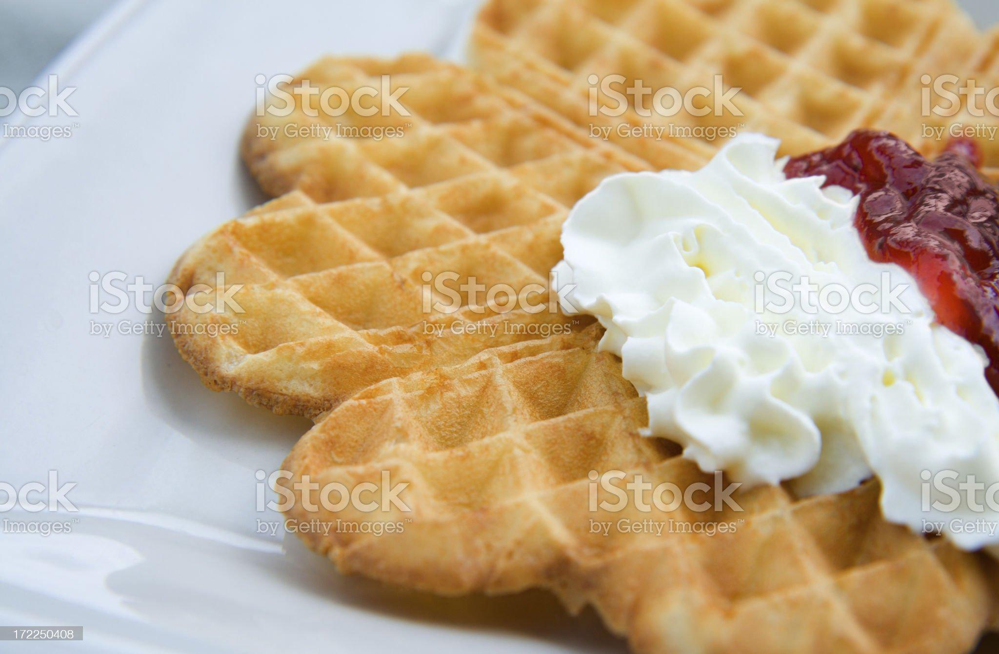 Swedish waffle with strawberry jam and whipped cream royalty-free stock photo