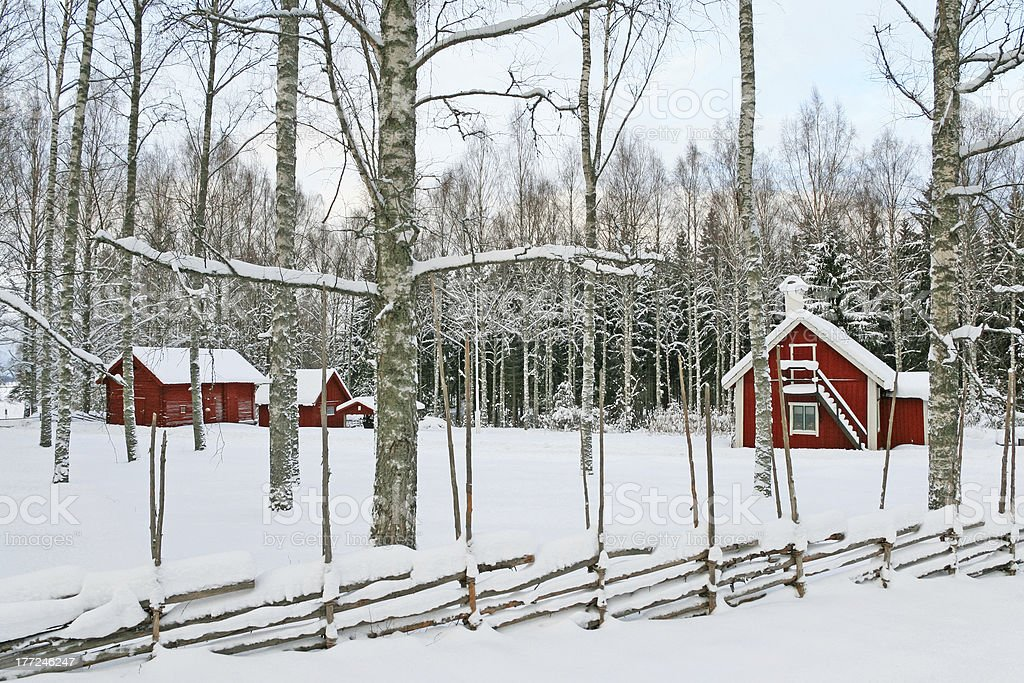 Swedish winter landscape with red wooden houses royalty-free stock photo