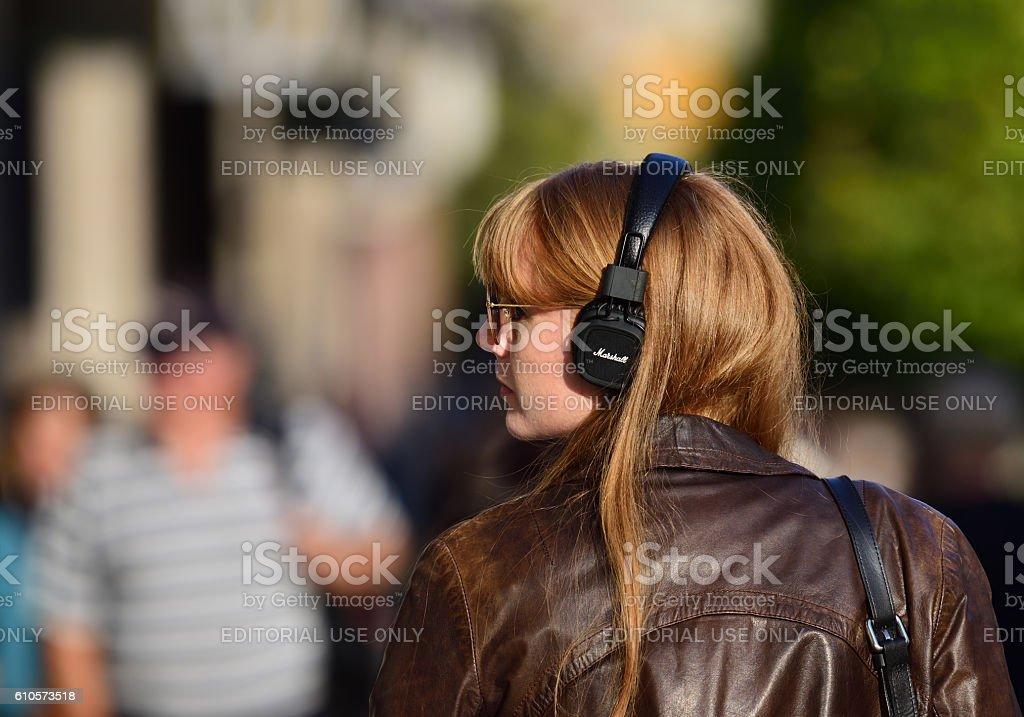Swedish young woman, headphones stock photo