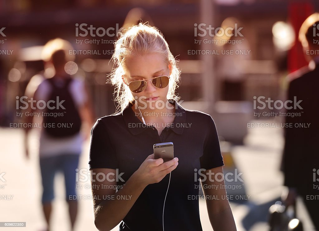 Swedish young woman, using mobile smart phone stock photo