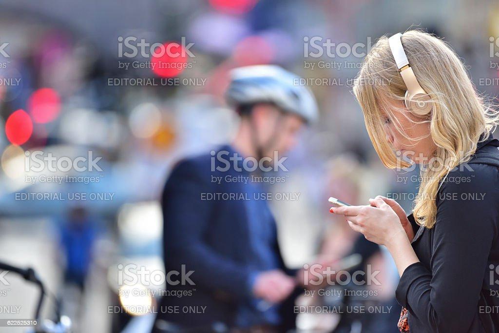 Swedish young woman, using mobile smart phone stock photo