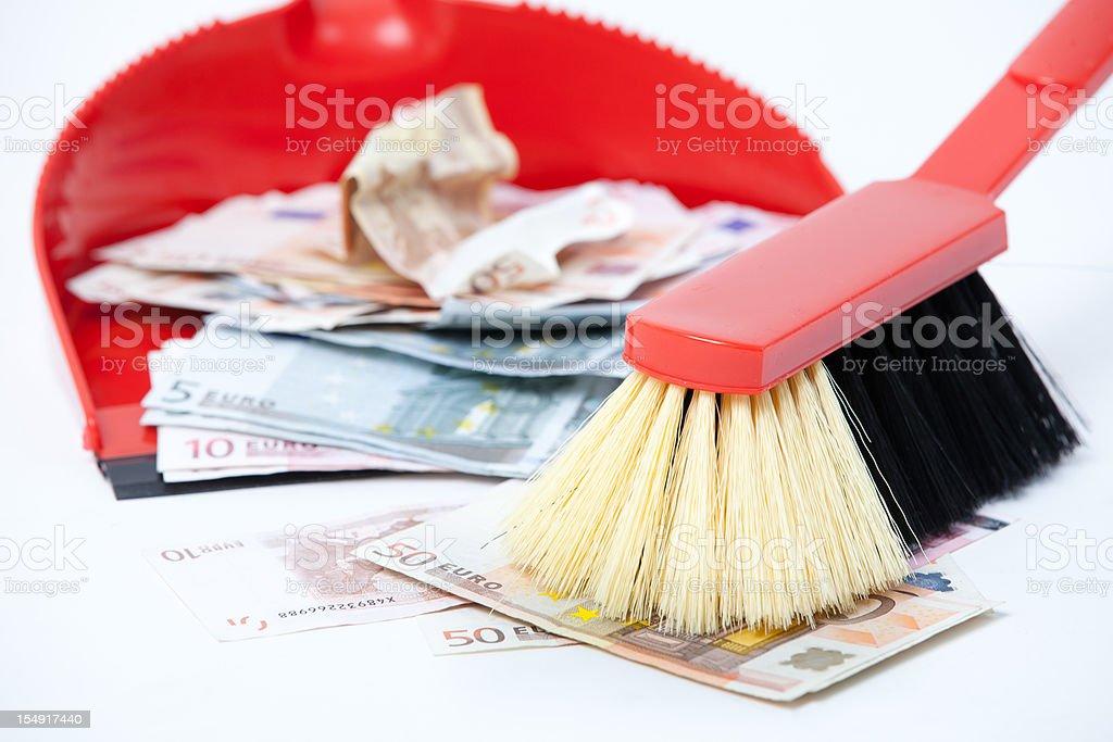 sweep the money stock photo