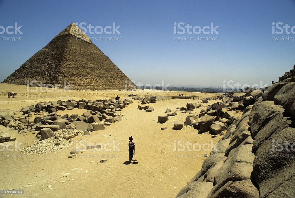 Sweeper At Pyramids stock photo