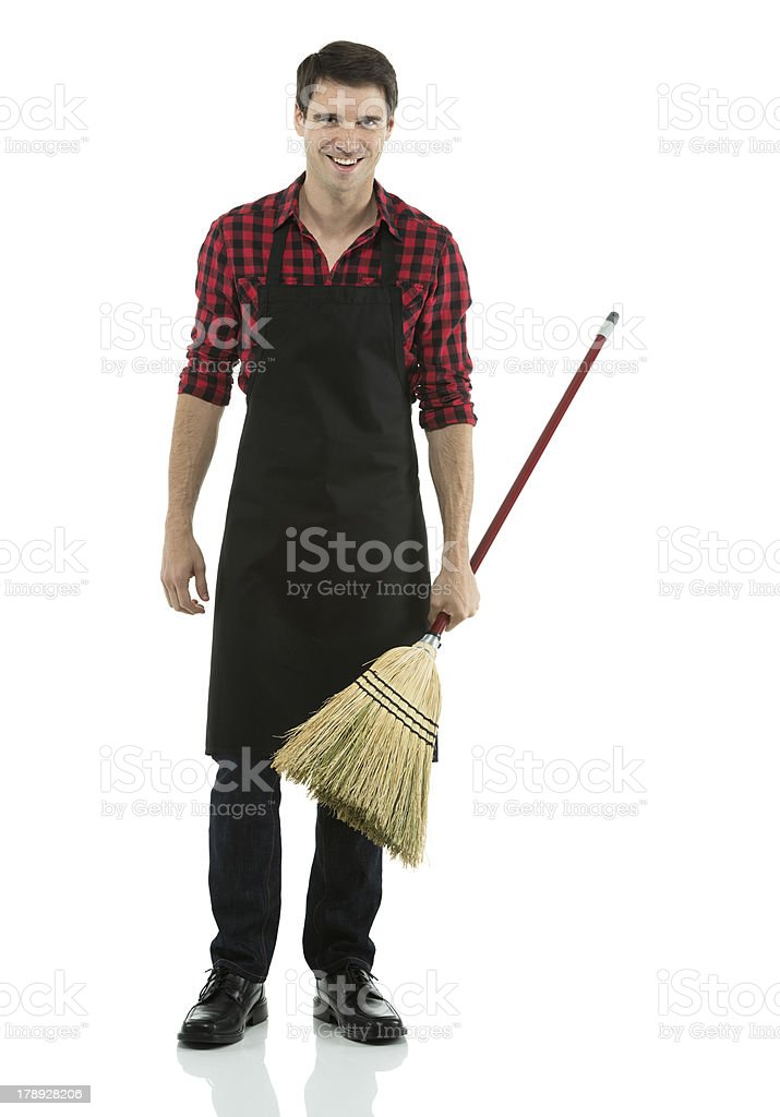 Sweeper with a broom royalty-free stock photo