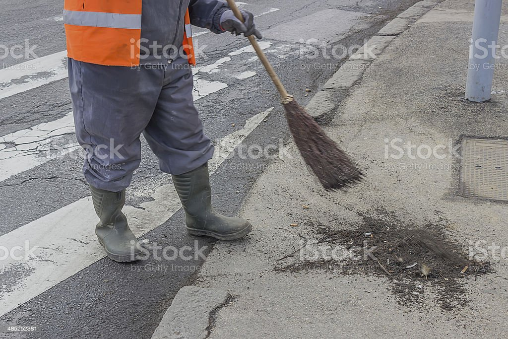 sweeping and pushing a broom 2 stock photo