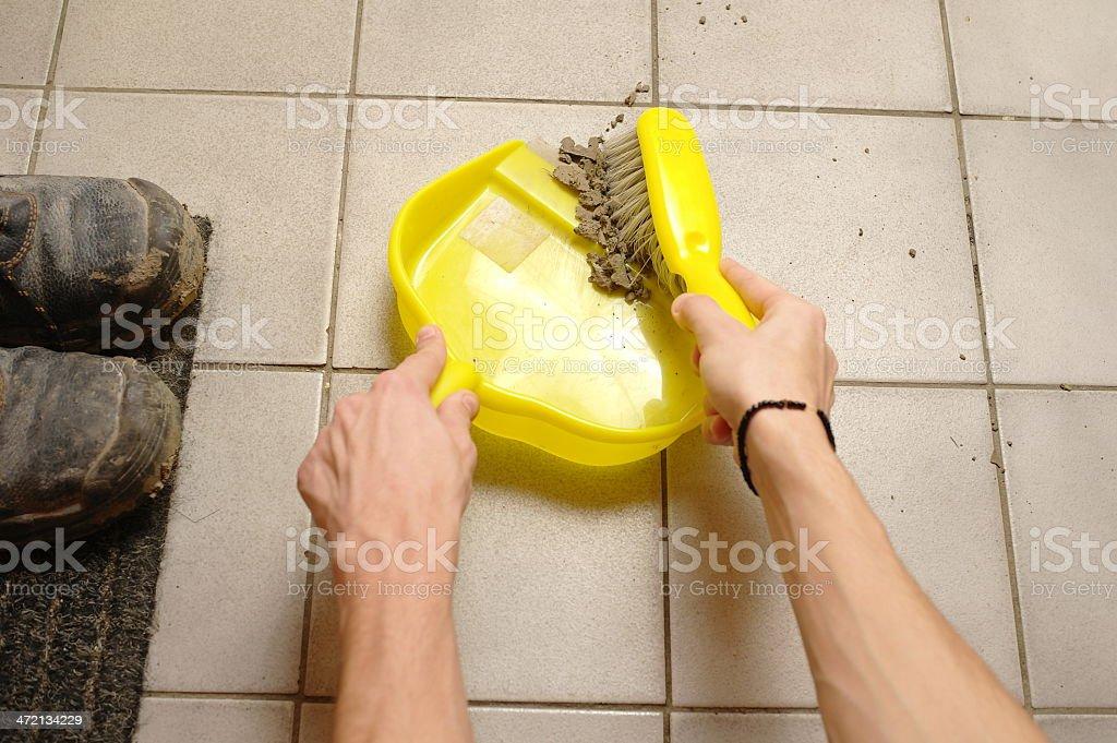 sweeping dirt stock photo