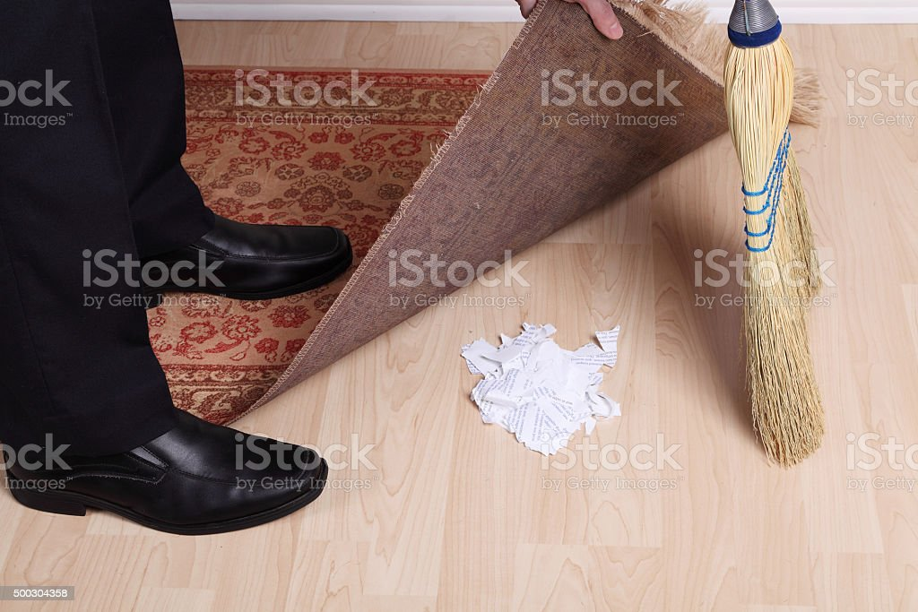 Sweeping Dirt Under the Rug stock photo