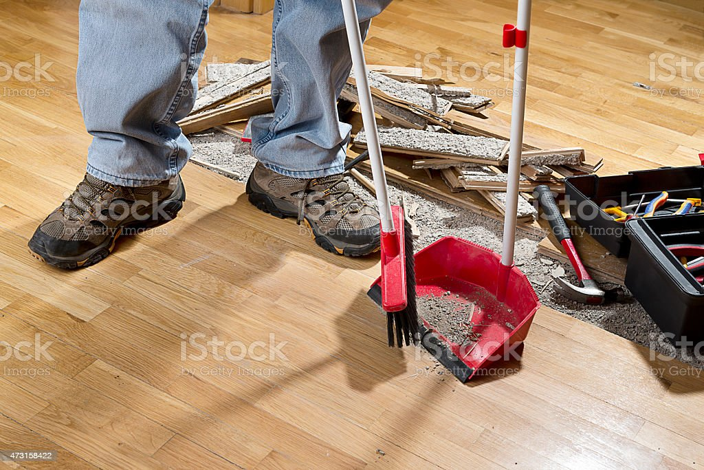 Sweeping Floor into Dustpan stock photo