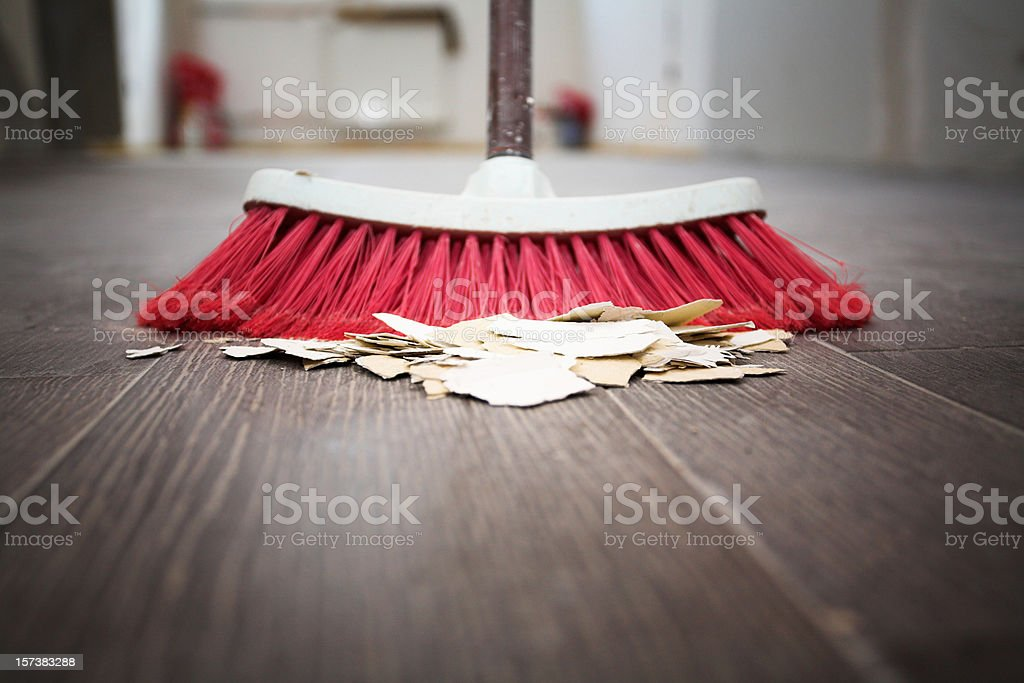 Sweeping floor with broom stock photo