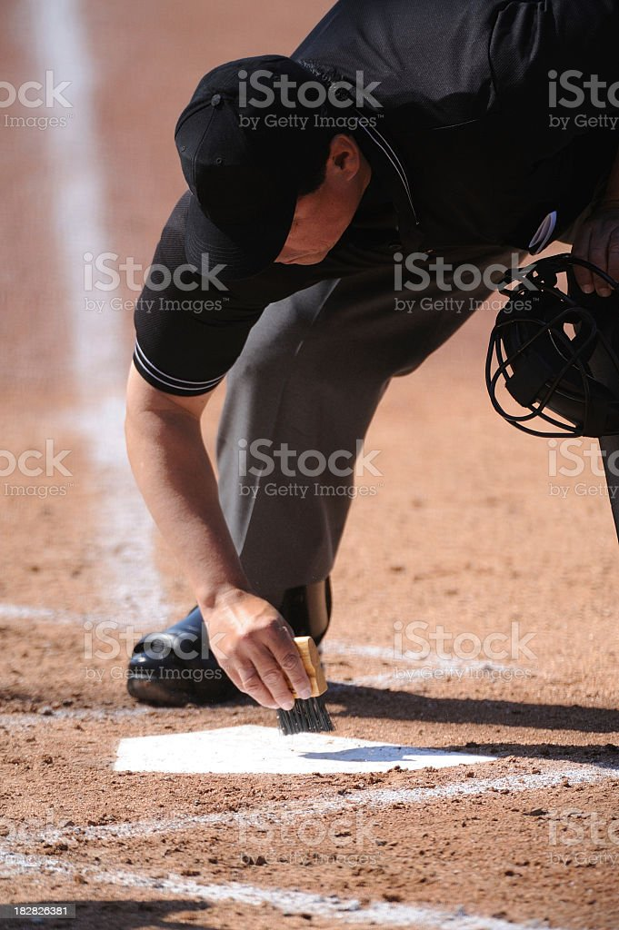Sweeping off the home plate for baseball game  stock photo