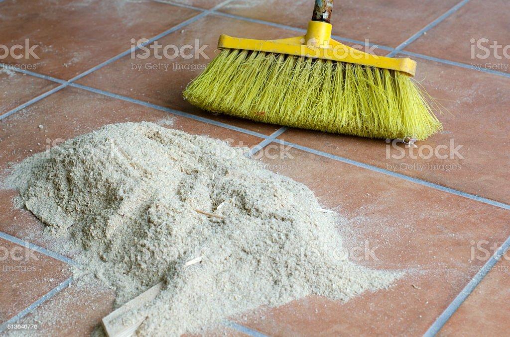 Sweeping sawdust stock photo
