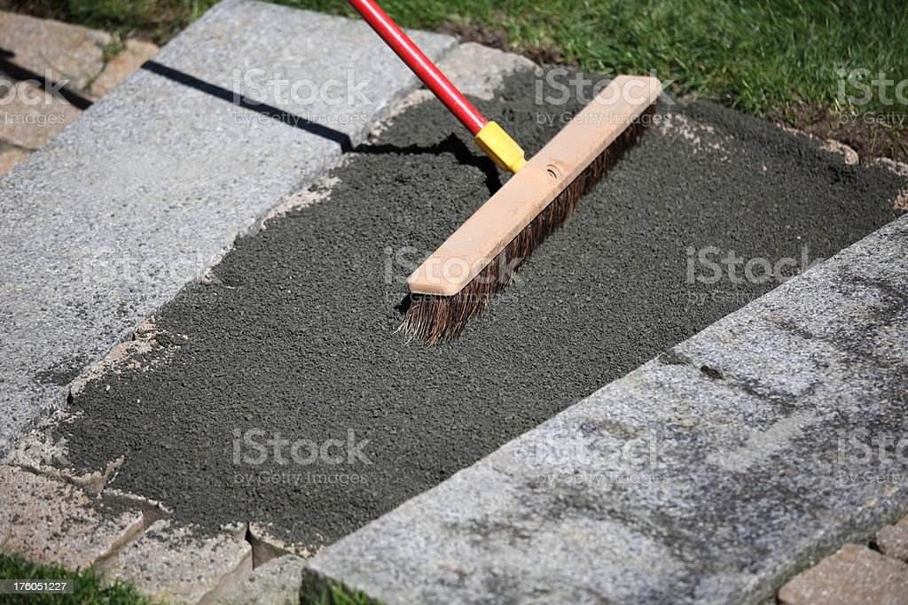Sweeping stone dust royalty-free stock photo