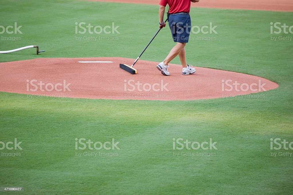 sweeping the pitcher's mound stock photo