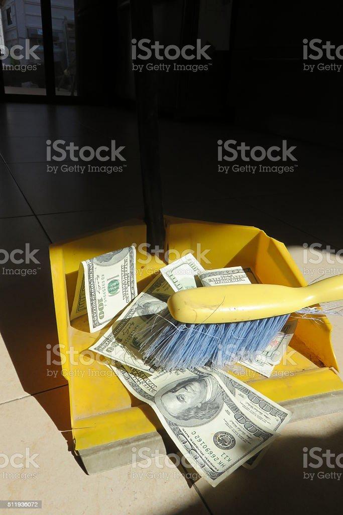 Sweeping Up Dollar Banknotes stock photo