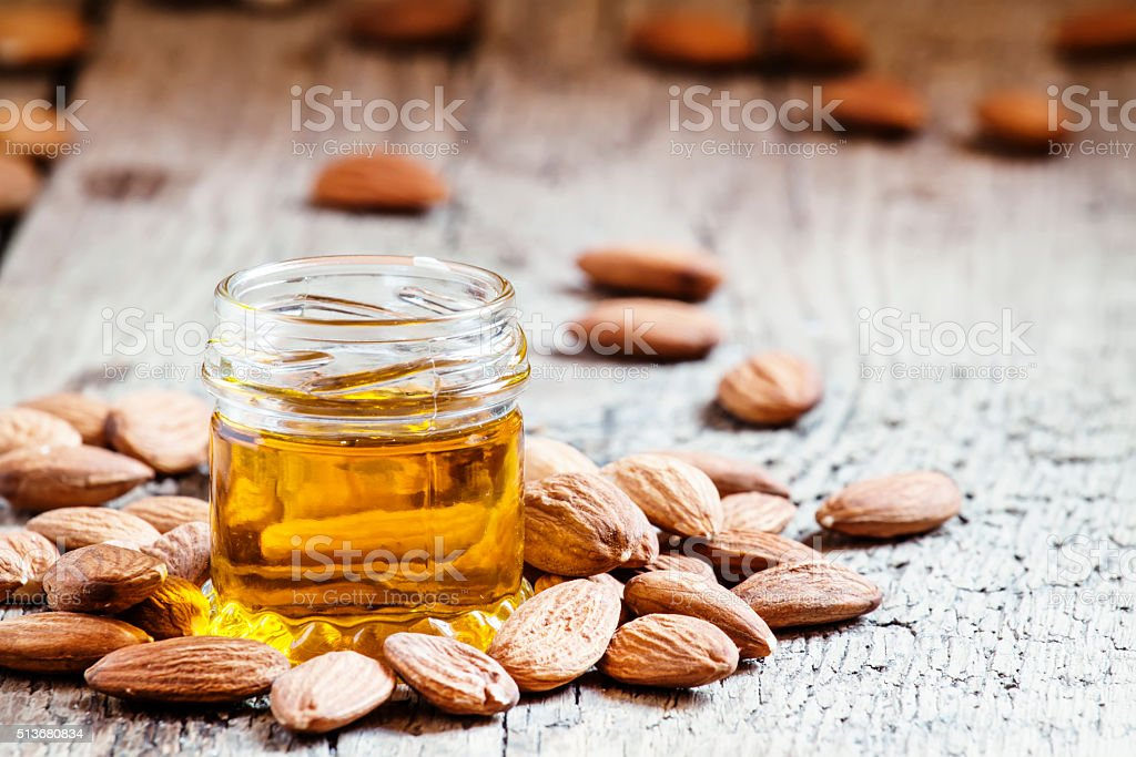 Sweet Almond Oil, first extraction, in a small glass jar stock photo