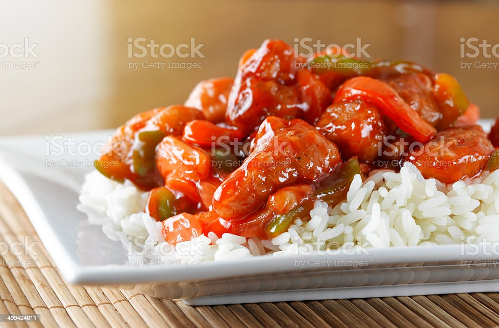 sweet and sour chicken on rice stock photo
