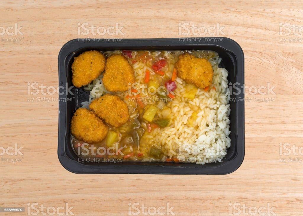 Sweet and sour chicken TV dinner on a table stock photo
