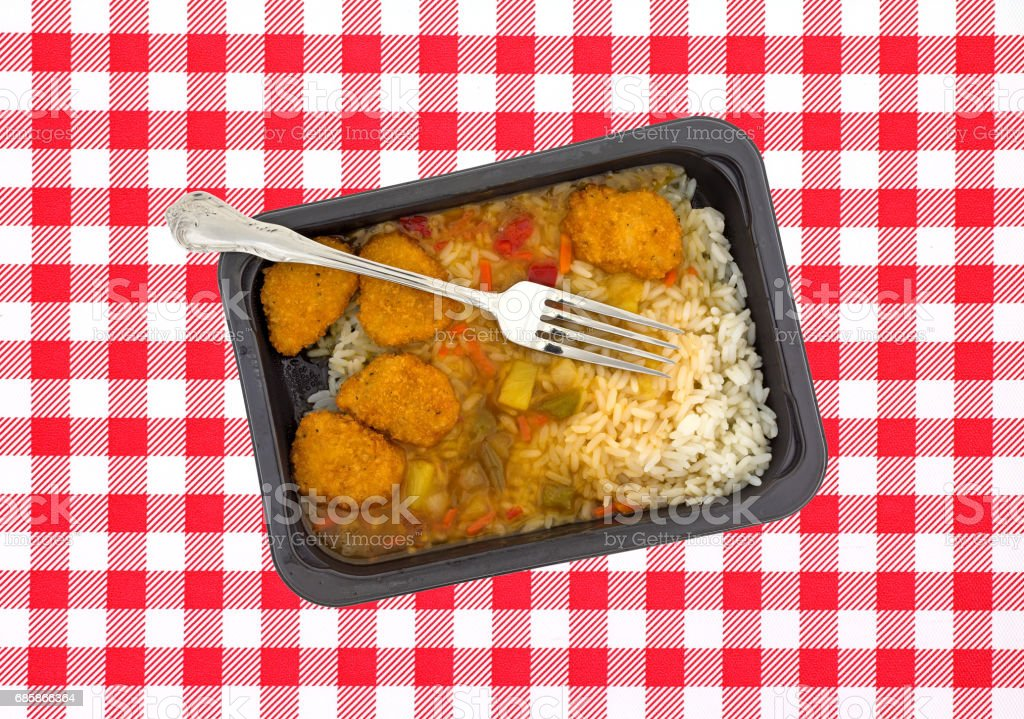 Sweet and sour chicken TV dinner with a fork stock photo