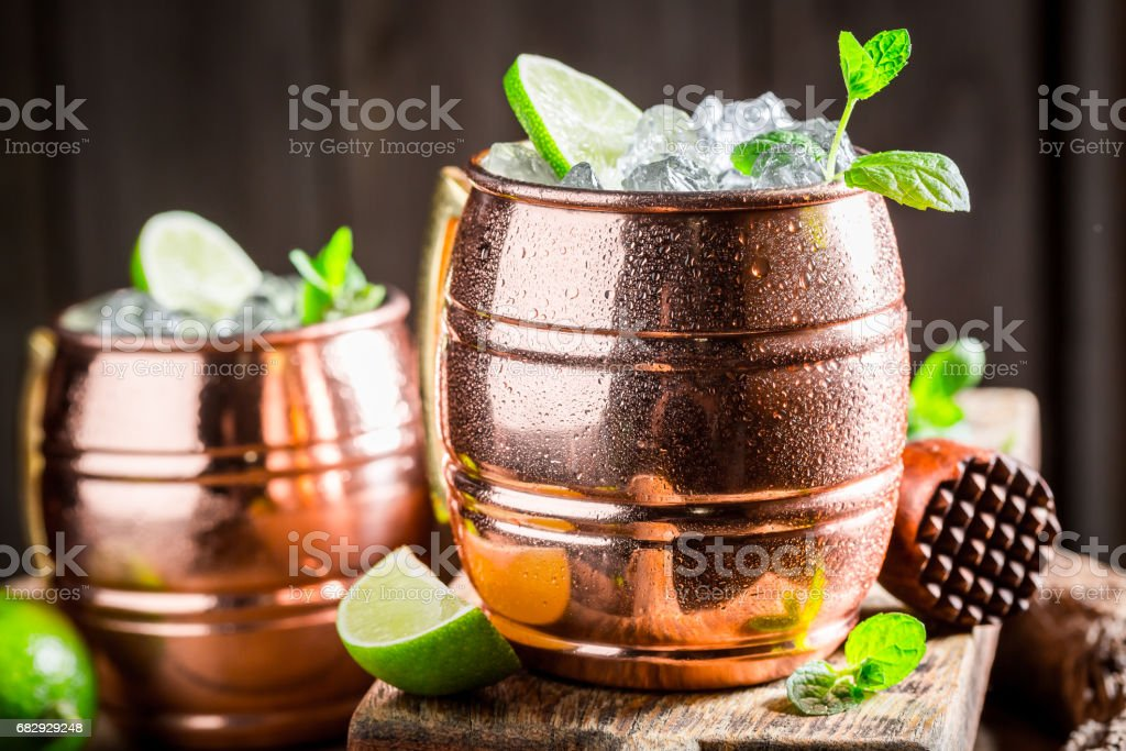 Sweet and sour cocktail made of rum and herbs stock photo
