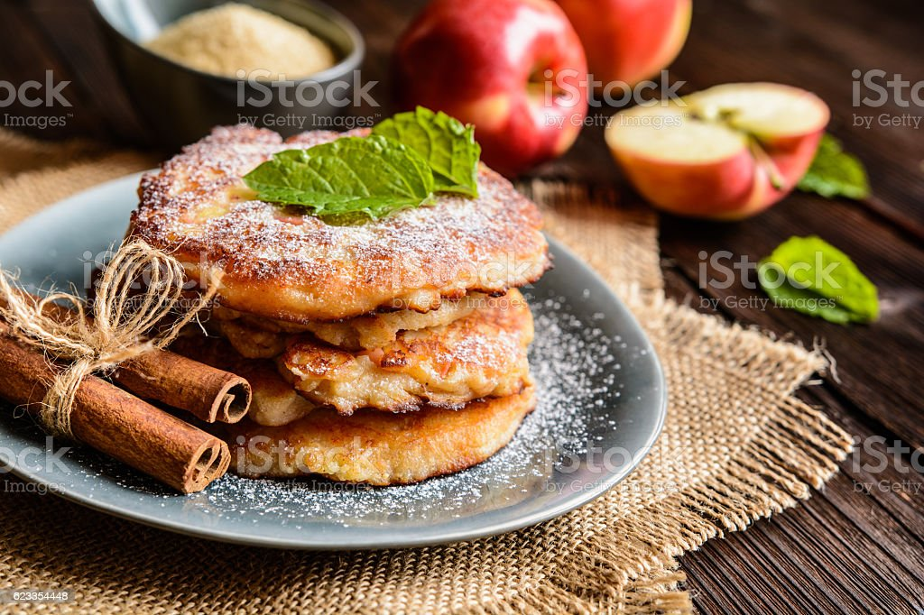 Sweet apple and curd pancakes stock photo