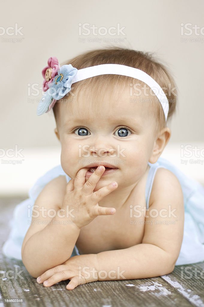 Sweet baby girl with vintage floral headband royalty-free stock photo