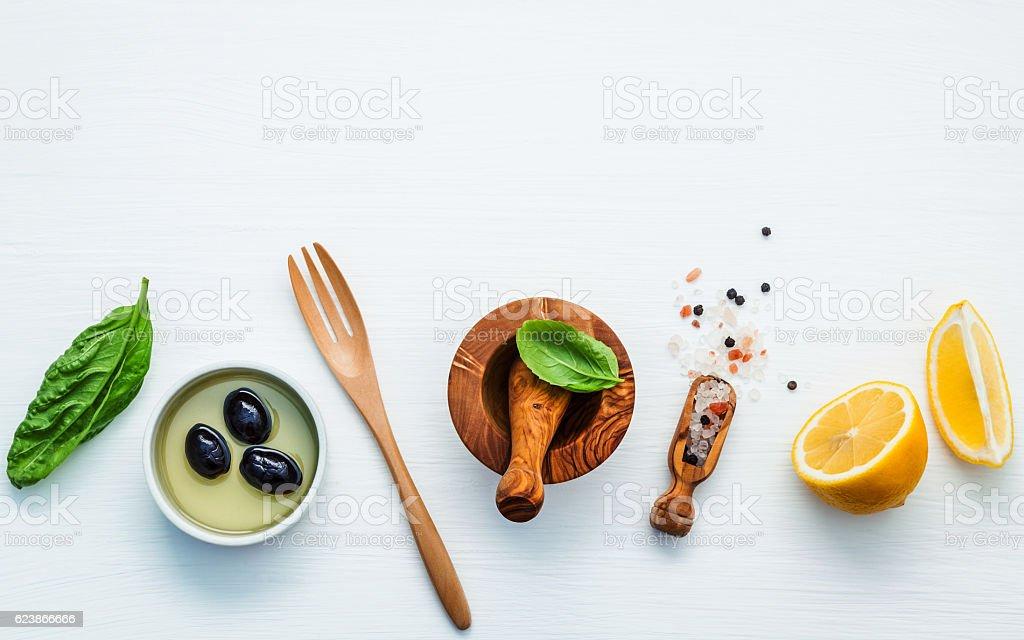 Sweet basil vinaigrette dressing ingredients on white wooden bac stock photo