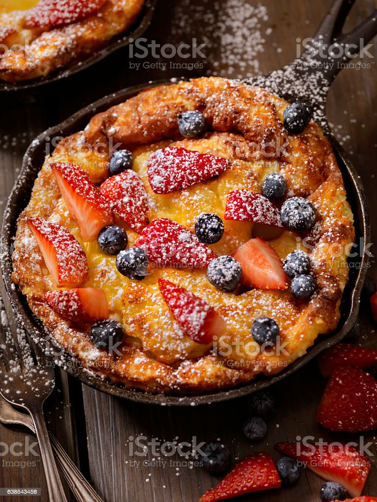 Sweet Berry Skillet, Dutch Baby Pancake stock photo