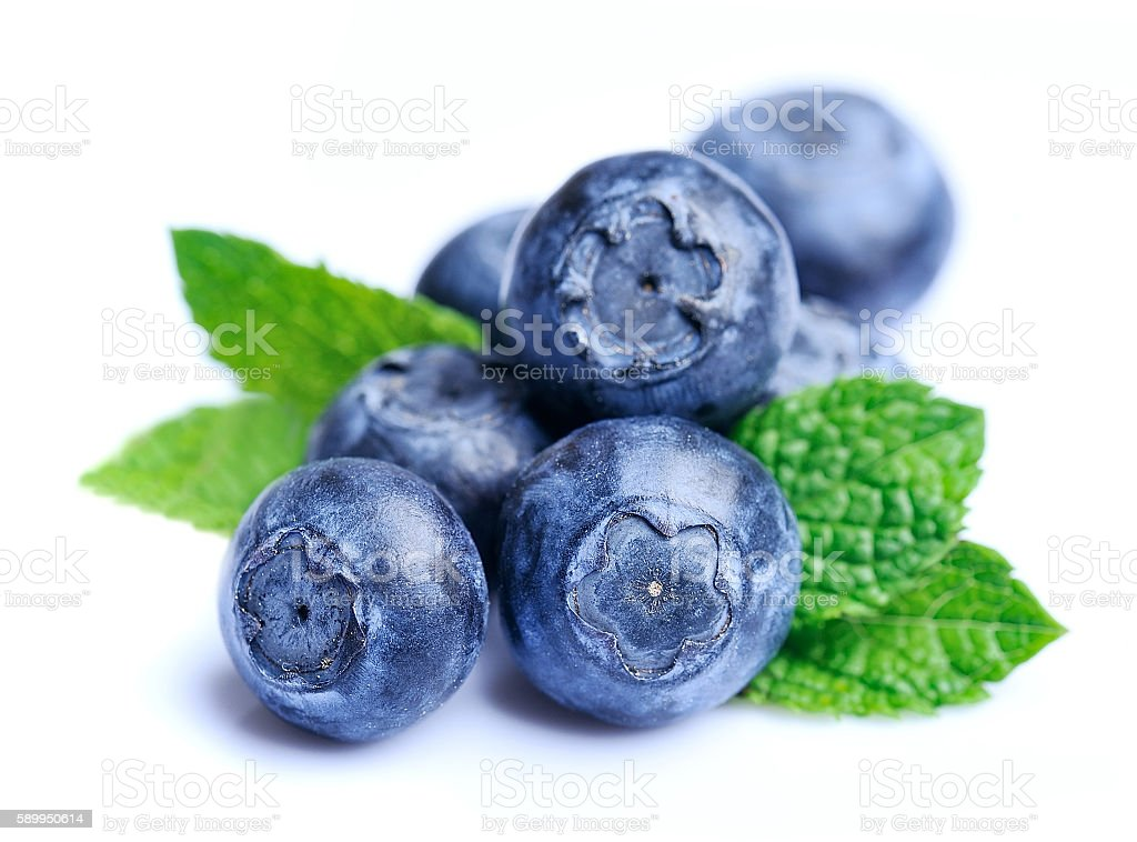Sweet blueberries with leaves stock photo