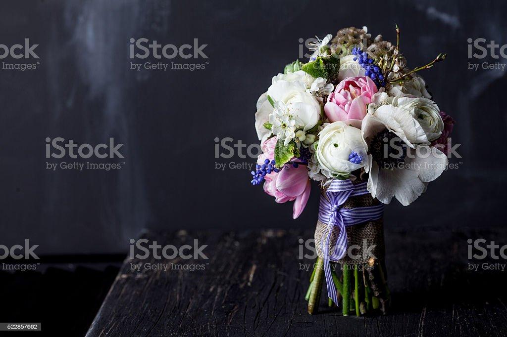 Sweet bouquet on dark old wood stock photo