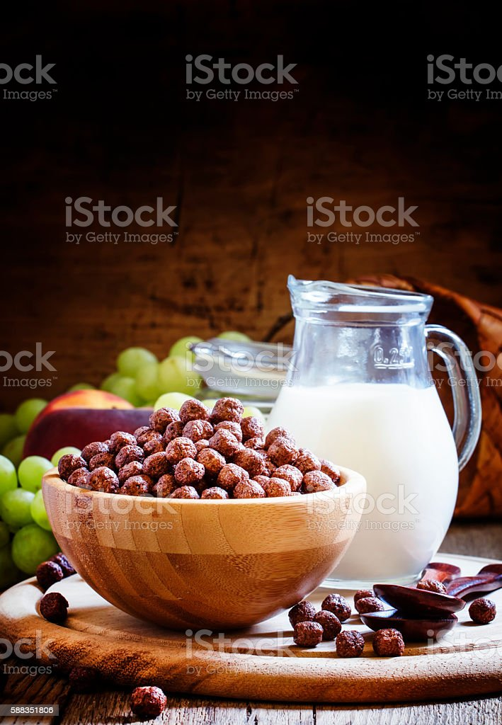 Sweet breakfast: cereal balls, milk, fruit stock photo