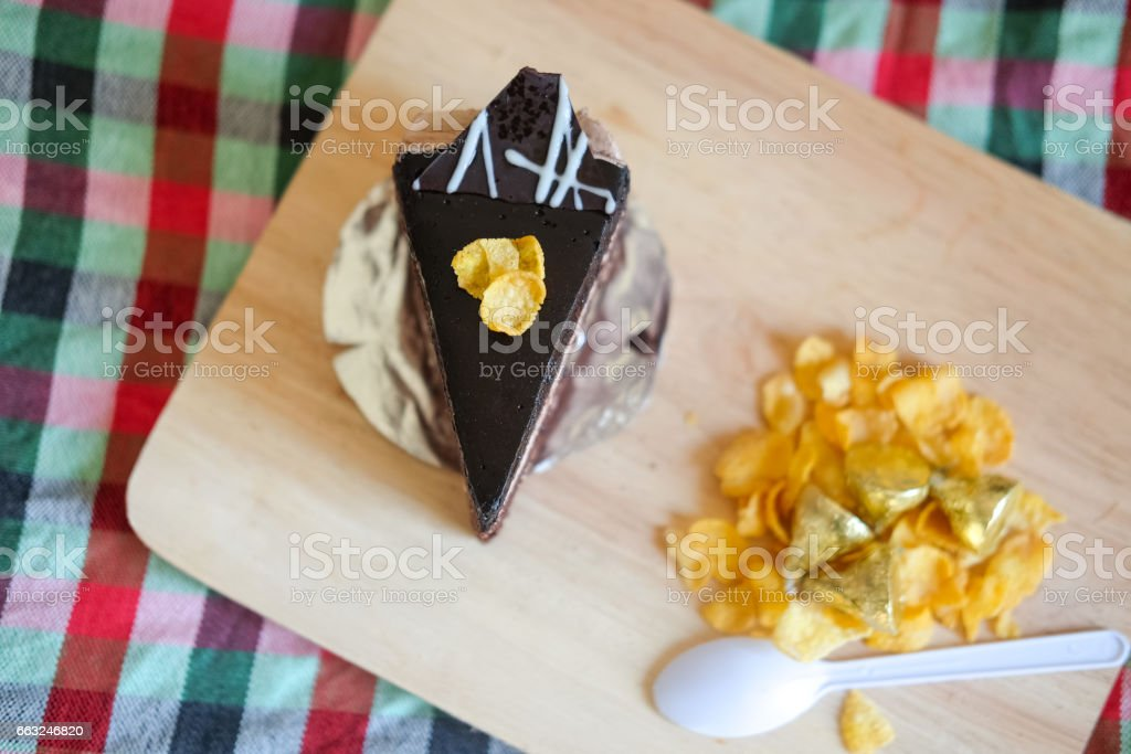 Sweet brownie chocolate cream cake topped with corn flakes stock photo