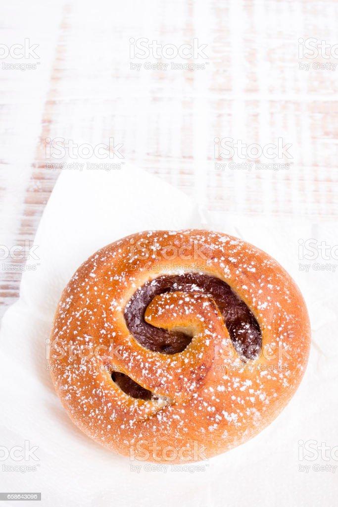 Sweet bun on white wooden background stock photo