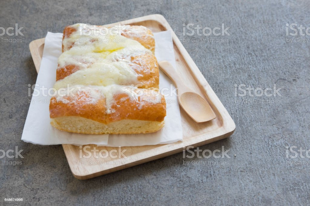 Sweet butter bread topping with butter and sugar on wooden tray stock photo