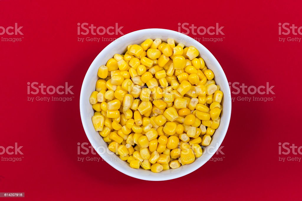 Sweet canned corn in small bowl stock photo